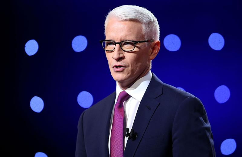 Debate moderator Anderson Cooper looks during the CNN Democratic Presidential Primary Debate between Democratic presidential candidate Hillary Clinton and candidate Senator Bernie Sanders at the Whiting Auditorium at the Cultural Center Campus on March 6, 2016 in Flint, Michigan. | Scott Olson—Getty Images