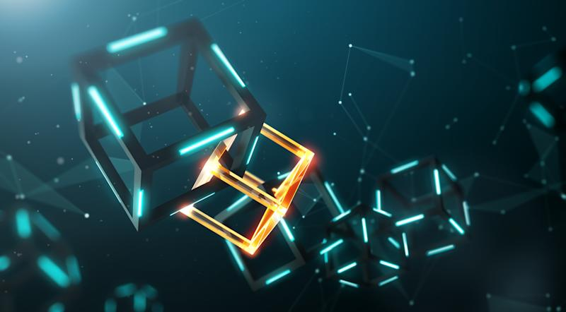 A chain of connected cubes; an orange one stands out