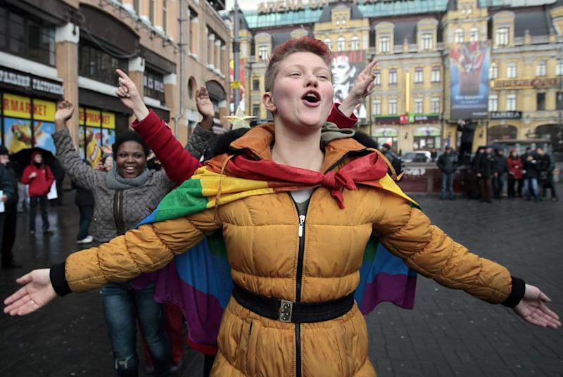 Lesbian, gay, bisexual, and transgender (LGBT) activists dance during a flash mob to support Ukraine's integration with the European Union in Kiev, Ukraine, Saturday, Jan. 11, 2014. Ukraine's ex-interior minister turned opposition leader was injured in a scuffle Saturday between police and anti-government activists, reflecting the high level of tensions after weeks of anti-government protests in the nation's capital. (AP Photo/Sergei Chuzavkov)