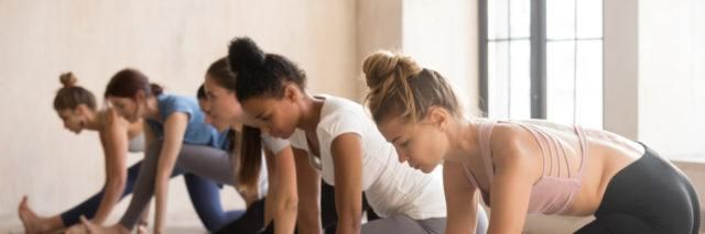 Group of women practicing Pilates.