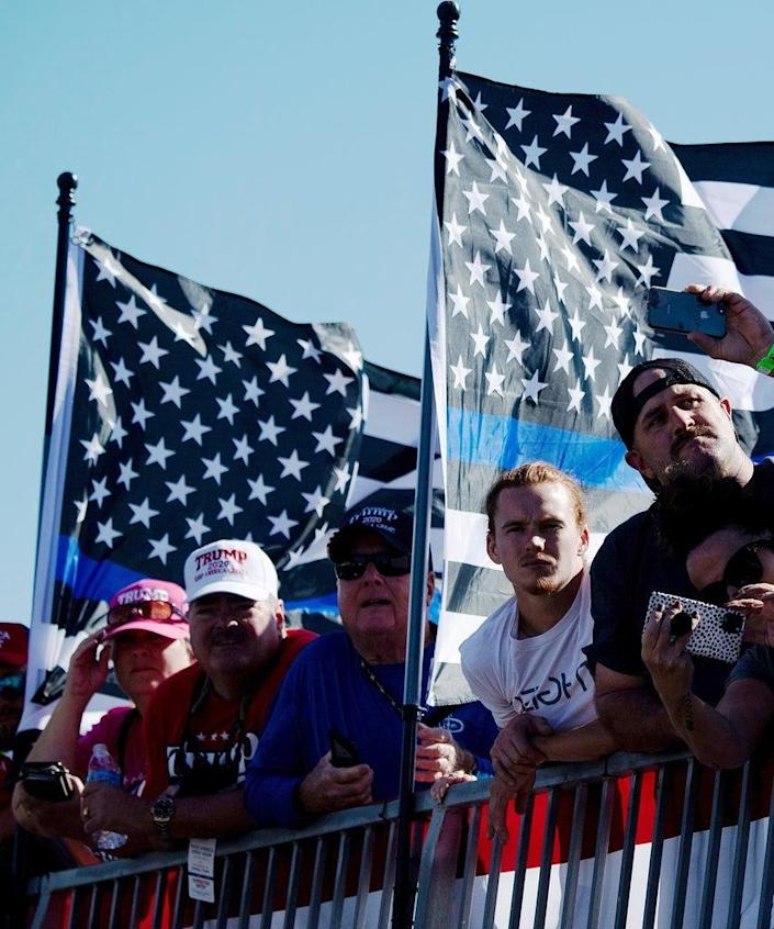 Supporters wait for US President Donald Trump to speak during a Make America Great Again rally at Laughlin/Bullhead International Airport October 28, 2020, in Bullhead City, Arizona. (Photo by Brendan Smialowski / AFP) (Photo by BRENDAN SMIALOWSKI/AFP via Getty Images)