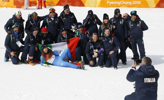 Alpine Skiing - Pyeongchang 2018 Winter Olympics - Women's Downhill - Jeongseon Alpine Centre - Pyeongchang, South Korea - February 21, 2018 - Gold medallist Sofia Goggia of Italy poses for photos with her team members. REUTERS/Leonhard Foeger