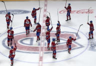 Montreal Canadiens players salute the fans after defeating the Toronto Maple Leafs 3-2 in overtime in Game 6 of an NHL hockey Stanley Cup first-round playoff seres Saturday, May 29, 2021, in Montreal. (Ryan Remiorz/The Canadian Press via AP)