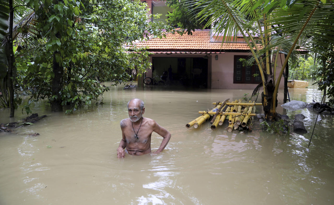 <p>An elderly man wades through flood waters to reach a boat carrying food supplies for stranded people in Chengannur in the southern state of Kerala, India, Sunday, Aug.19, 2018. (AP Photo/Aijaz Rahi) </p>