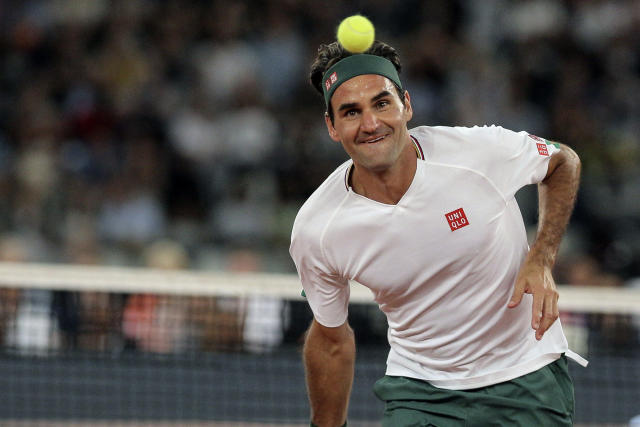 Roger Federer in action during the exhibition tennis match against Rafael Nadal held at the Cape Town Stadium in Cape Town, South Africa, Friday Feb. 7, 2020. (AP Photo/Halden Krog)