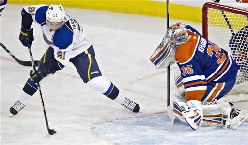 St. Louis Blues' Vladimir Tarasenko, 91, is stopped by Edmonton Oilers goalie Nikolai Khabibulin during first period NHL hockey action in Edmonton, Alberta, on Saturday March 23, 2013. (AP Photo/The Canadian Press, Jason Franson)