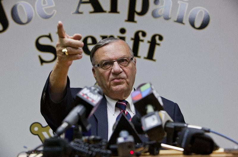Maricopa County Sheriff Joe Arpaio, talks with Media members Friday night Aug. 31, 2012 at his offices in downtown Phoenix. Federal authorities said Friday that they're closing their abuse-of-power investigation into Maricopa County Sheriff Joe Arpaio in Arizona without filing charges against him. (AP Photo/Dave Seibert, The Arizona Republic)