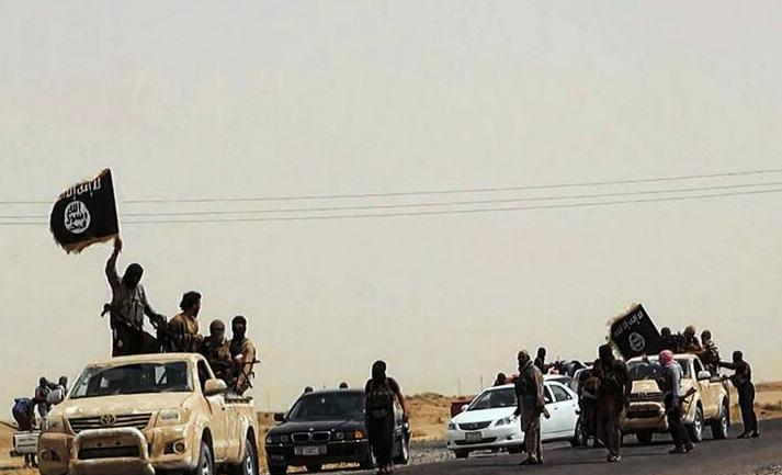 An image uploaded on June 14, 2014 on the jihadist website Welayat Salahuddin allegedly shows militants of the Islamic State of Iraq and the Levant (ISIL) driving on a street at unknown location in the Salaheddin province (AFP Photo/)