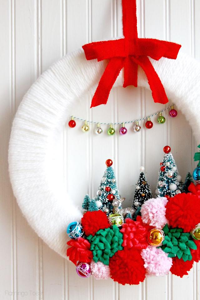 """<p>This colorful, vintage-inspired craft is sure to make your front door merry and bright.</p><p><strong>Get the tutorial at <a rel=""""nofollow"""" href=""""https://flamingotoes.com/vintage-style-winter-wonderland-wreath/?crlt.pid=camp.7i5KRfmqVwqD"""">Flamingo Toes</a>.</strong></p><p><strong><a rel=""""nofollow"""" href=""""https://www.amazon.com/KUUQA-Plastic-Ornaments-Tabletop-Decoration/dp/B077D43FZC"""">SHOP BOTTLE BRUSH TREES</a><br></strong></p>"""