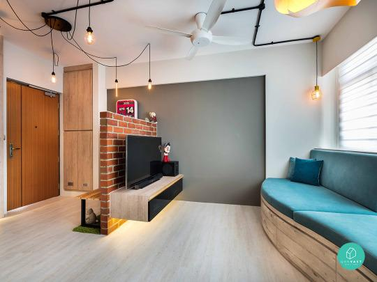 The Owner Uses The Brick Wall Not Just As A Separator Between The Living  Room And Walkway But Also As A TV Backing On One Side And Seating Area For  The ...