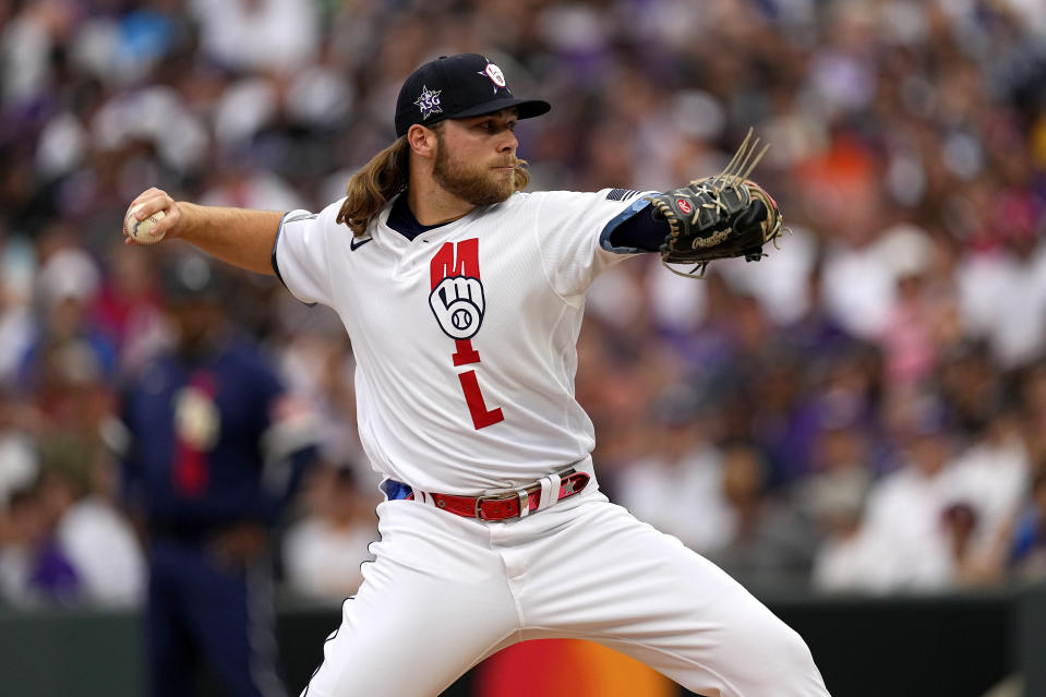 National League's Corbin Burnes, of the Milwaukee Brewers, throws during the second inning of the MLB All-Star baseball game, Tuesday, July 13, 2021, in Denver. (AP Photo/Jack Dempsey)