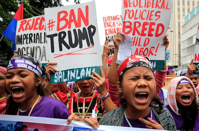 <p>Members of the GABRIELA (Women's Group) shout anti-U.S. government slogans while denouncing the planned visit of U.S. President Donald Trump to attend the 31st Association of Southeast Asian Nations (ASEAN) leaders summit during a protest outside the U.S. Embassy in metro Manila, Philippines, Nov. 9, 2017. (Photo: Romeo Ranoco/Reuters) </p>
