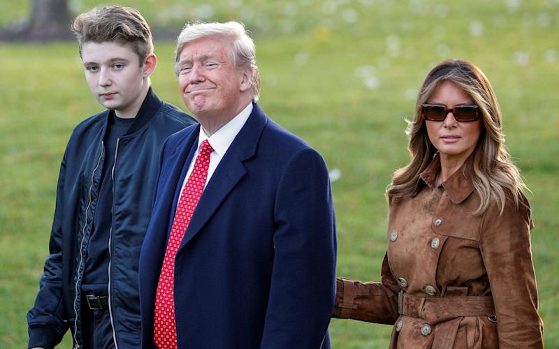 US President Donald Trump with son Barron and First Lady Melania Trump - REUTERS/Tom Brenner