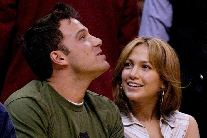 Actors Ben Affleck and Jennifer Lopez sit together at the Los Angeles Lakers' game against the San Antonio Spurs during at the Western Conference Semi-Finals game, Saturday night, May 11, 2003, in Los Angeles. The Lakers won the game 99-95 to tie the series at 2-2. (AP Photo/Mark J. Terrill)
