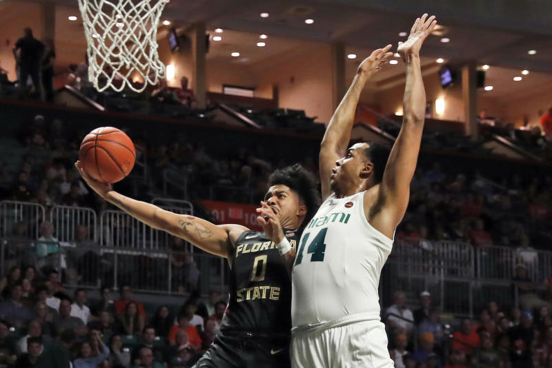 Florida State guard Rayquan Evans (0) shoots the ball against Miami center Rodney Miller Jr. (14) during the first half of an NCAA college basketball game on Saturday, Jan. 18, 2020, in Coral Gables, Fla. (AP Photo/Brynn Anderson)