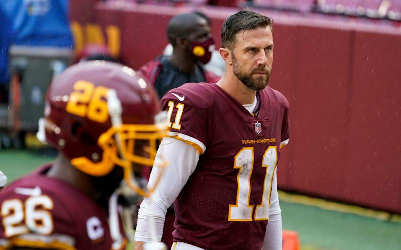 Washington Football Team's Alex Smith walks off the field after an NFL football game against the Los Angeles Rams Sunday, Oct. 11, 2020, in Landover, Md. The Rams won 30-10. - AP