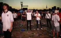 FILE - In this July 11, 2018 file photo England soccer fans react after losing the semifinal match between Croatia and England at the 2018 soccer World Cup, in Hyde Park, London. (AP Photo/Matt Dunham, File)