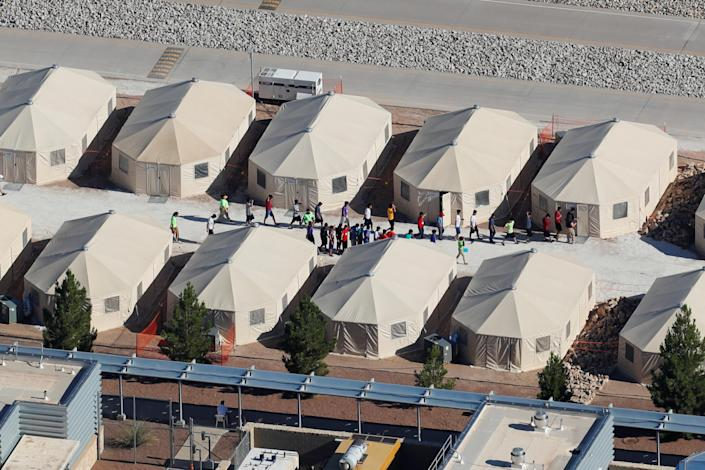 """<span class=""""s1"""">Immigrant children, many of whom have been separated from their parents, are being housed in this compound next to the Mexico border in Tornillo, Texas, in June. (Photo: Mike Blake/Reuters)</span>"""
