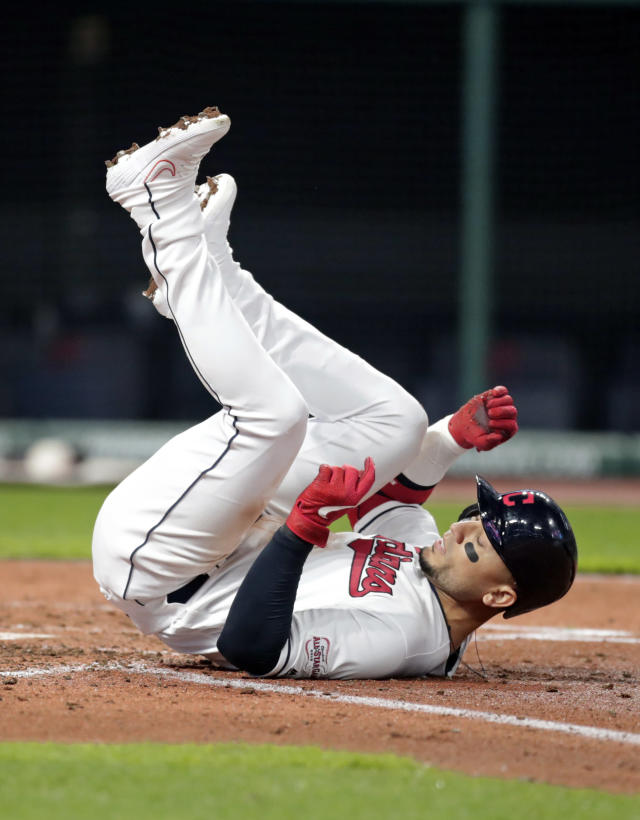 Cleveland Indians' Carlos Gonzalez rolls on the ground after being hit by pitch in the second inning during the second game of a baseball doubleheader against the Atlanta Braves, Saturday, April 20, 2019, in Cleveland. (AP Photo/Tony Dejak)