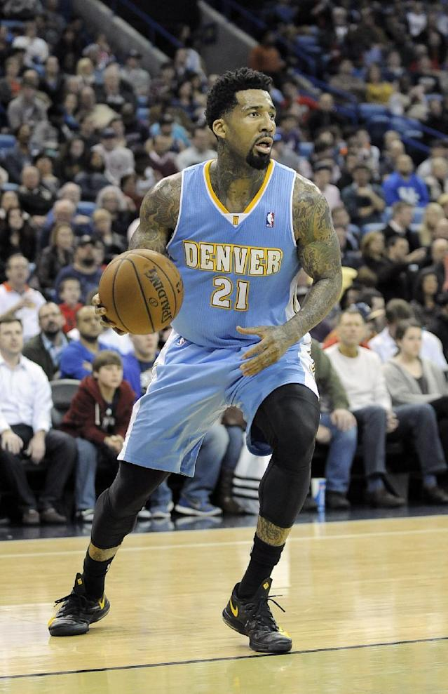 Denver Nuggets forward Wilson Chandler grabs a loose ball in the second half of an NBA basketball game against the New Orleans Pelicans in New Orleans, Friday, Dec. 27, 2013. New Orleans won 105-89. (AP Photo/Stacy Revere)