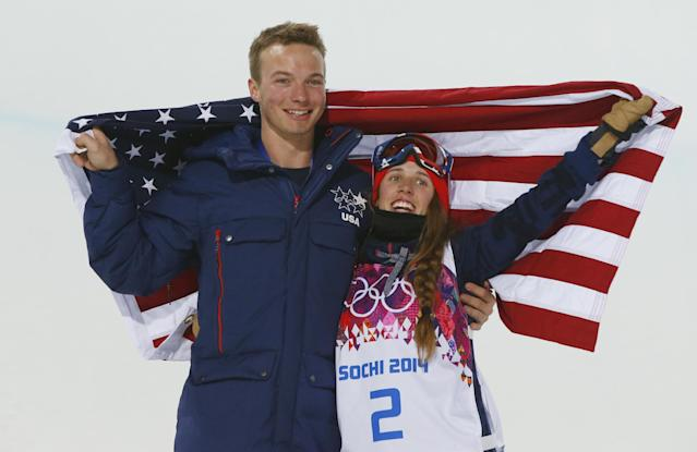 Maddie Bowman of the United States celebrates her gold medal in the women's ski halfpipe final, with compatriot David Wise, the men's half pipe gold medal winner, at the Rosa Khutor Extreme Park, at the 2014 Winter Olympics, Thursday, Feb. 20, 2014, in Krasnaya Polyana, Russia.(AP Photo/Sergei Grits)