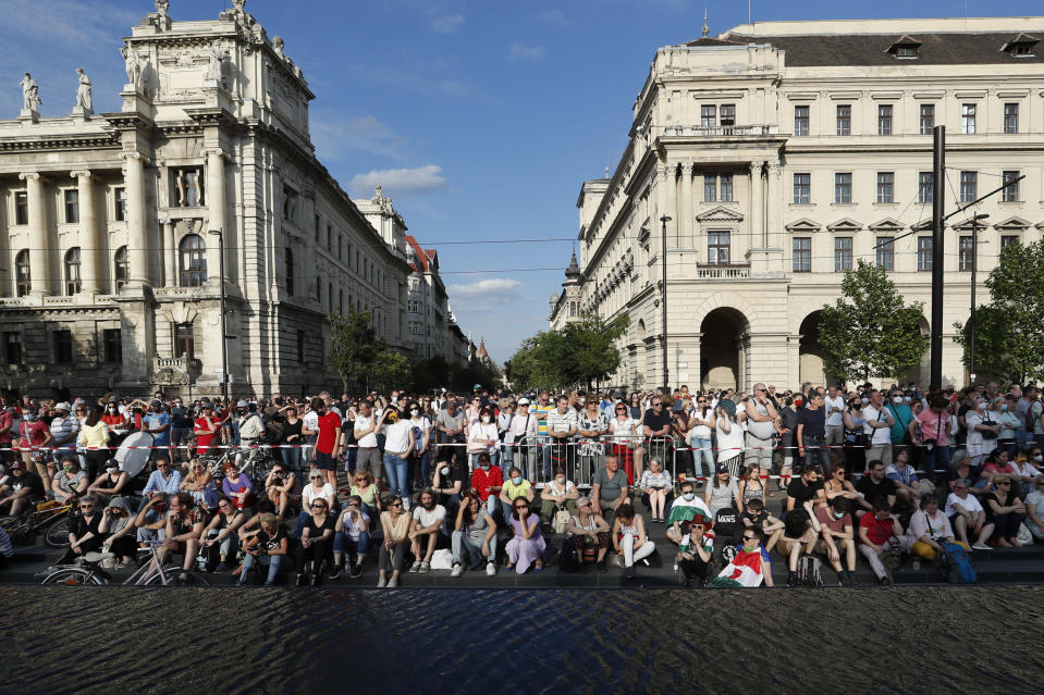 Protesters gather in downtown Budapest, Hungary, Saturday, June 5, 2021. Thousands of people gathered opposing the Hungarian government's plan of building a campus for China's Fudan University in Budapest. (AP Photo/Laszlo Balogh)