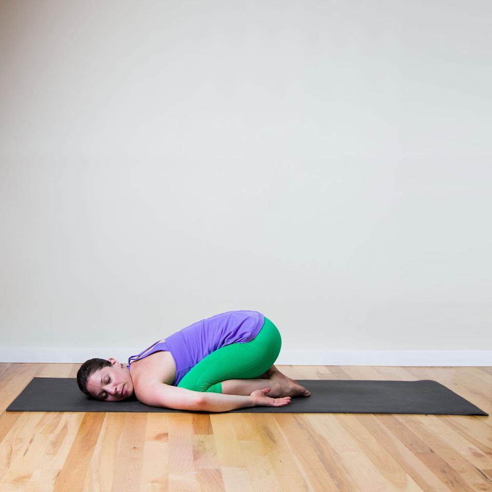 <p>This variation of Child's Pose feels the most gentle.</p> <ul> <li>Kneel on your mat with your knees hips-width distance apart, and your big toes touching behind you. </li> <li>Take a deep breath in and as you exhale, lie your torso over your thighs. Try to lengthen your neck and spine by drawing your ribs away from your tailbone and the crown of your head away from your shoulders.</li> <li>Rest your arms beside your legs, with palms facing up, resting your cheek on the floor.</li> <li>Stay here for five breaths, then turn your head the other way and stay for another five.</li> </ul>