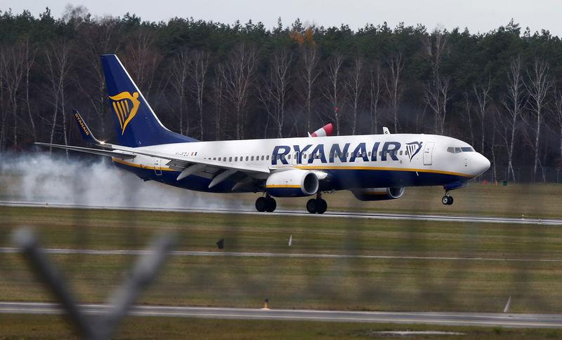 FILE PHOTO: A Ryanair aircraft lands at the airport in Modlin near Warsaw, Poland