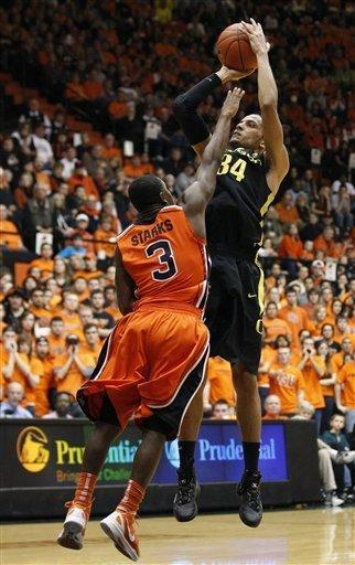 Oregon's Devoe Joseph (34) shoots as Oregon State guard Ahmad Starks (3) defends in the second half of an NCAA college basketball game, Sunday, Feb. 26, 2012, in Corvallis, Ore. Oregon defeated Oregon State 74-73. (AP Photo/Rick Bowmer)