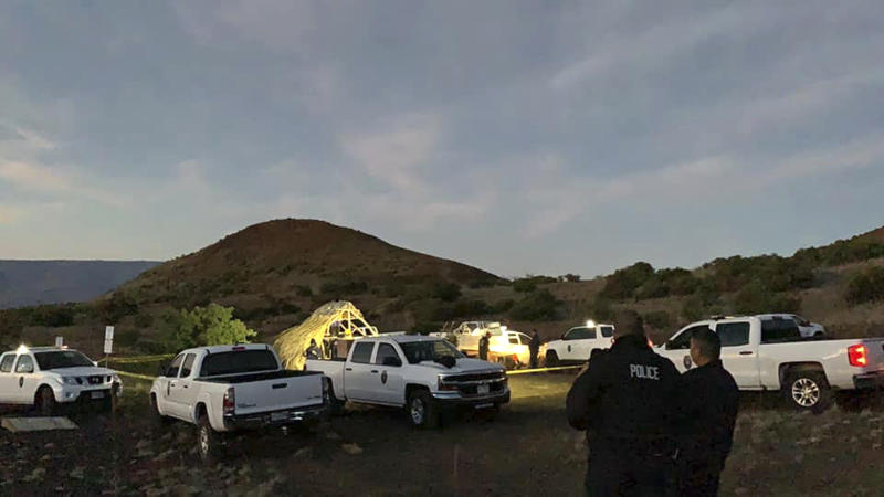 """In this photo provided by Pi'ikea Keawekane-Stafford, state and county officials remove Native Hawaiian structures from Mauna Kea, Thursday, June 20, 2019. After years of protests and legal battles, Hawaii officials announced Thursday that a massive telescope which will allow scientists to peer into the most distant reaches of our early universe will be built on a volcano that some consider sacred. The state has issued a """"notice to proceed"""" for the Thirty Meter Telescope project, Gov. David Ige said at a news conference. Ige said four unauthorized structures were removed from the Mauna Kea mountain earlier in the day. (Pi'ikea Keawekane-Stafford via AP)"""