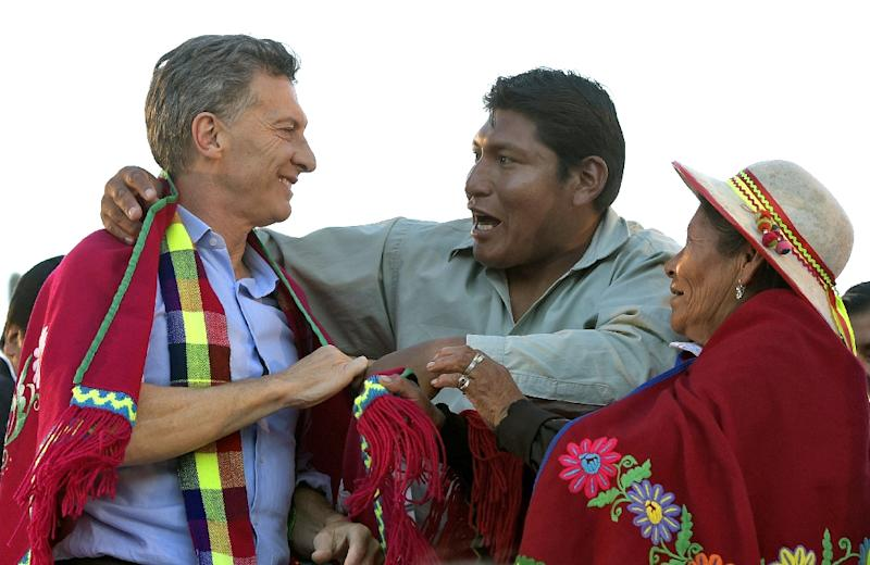 Presidential candidate for Cambiemos party Mauricio Macri (L) is congratulated by an indigenous representatives at a rally in Humahuaca, Argentina on November 19, 2015 (AFP Photo/Juan Mabromata)