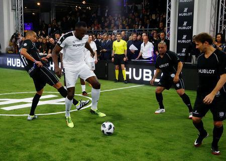 Soccer Football - Hublot Match of Friendship - Congress Center, Basel, Switzerland - March 21, 2018. Usain Bolt of Team Jose Mourinho in action with David Trezeguet, Roberto Carlos and Gaizka Mendieta of Team Diego Maradona . REUTERS/Arnd Wiegmann