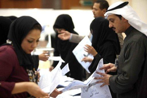 Ballots are counted at a polling station in the Sabah al-Salem district