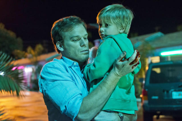 "Michael C. Hall as Dexter Morgan and Jadon Wells as Harrison in the ""Dexter"" Season 8 premiere, ""A Beautiful Day."""