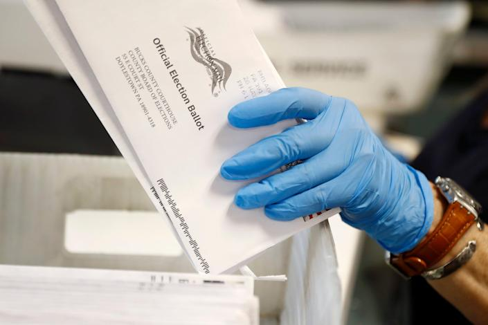 A worker processes mail-in ballots at the Bucks County Board of Elections office ahead of the primary election in Doylestown, Pa., May 27.