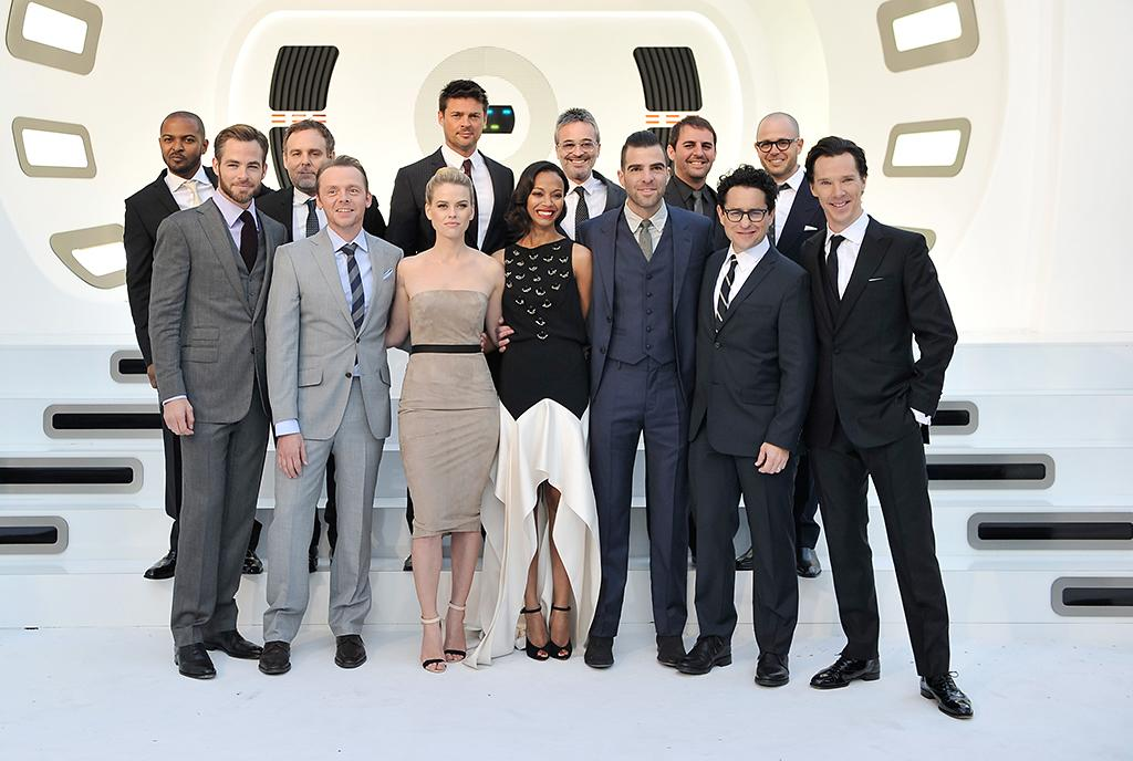 "(Front L-R) Actors Alice Eve, Chris Pine, Zoe Saldana, Zachary Quinto, Zoe Saldana, director J.J. Abrams and Benedict Cumberbatch (Back L-R) Noel Clark, producer Bryan Burk, actor Karl Urban, writer Alex Kurtzman, writer Roberto Orci and producer Damon Lindelof attend the UK Premiere of ""Star Trek Into Darkness"" at The Empire Cinema on May 2, 2013 in London, England.  (Photo by Gareth Cattermole/Getty Images for Paramount Pictures)"