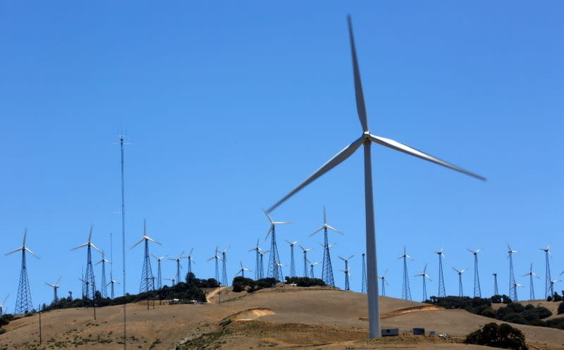 FILE PHOTO: A GE 1.6-100 wind turbine (front R) is pictured at a wind farm in Tehachapi