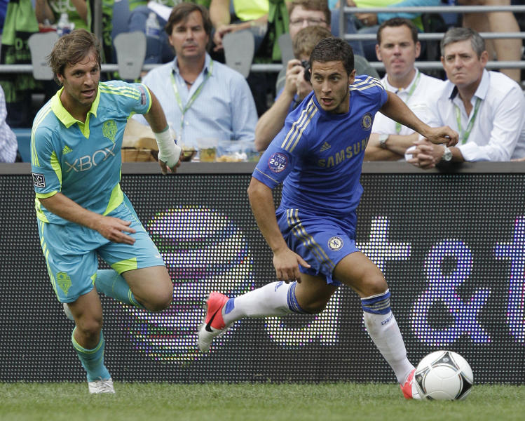Chelsea's Eden Hazard, right, breaks away from Seattle Sounders' Jeff Parke just before Hazard scored a goal in the first half of an exhibition soccer match, Wednesday, July 18, 2012, in Seattle. (AP Photo/Ted S. Warren)