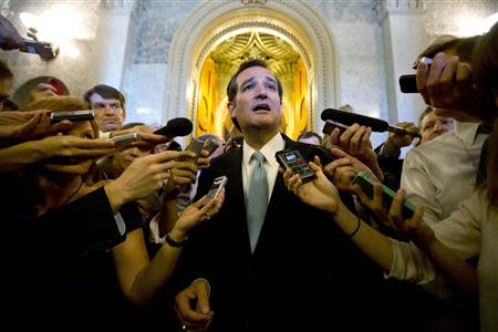 "U.S. Senator Ted Cruz (R-TX) speaks to the press after leaving the Senate Chamber after a marathon attack on ""Obamacare,"" at the U.S. Capitol in Washington, September 25, 2013. REUTERS/Jason Reed (UNITED STATES - Tags: POLITICS TPX IMAGES OF THE DAY)"