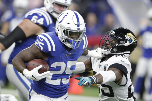 Indianapolis Colts running back Marlon Mack, front left, runs past Jacksonville Jaguars' D.J. Hayden, right, during the first half of an NFL football game, Sunday, Nov. 17, 2019, in Indianapolis. (AP Photo/Michael Conroy)