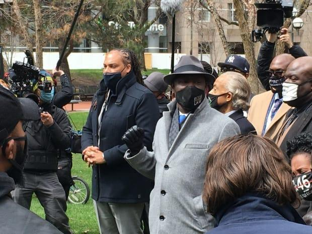 Ben Crump, centre, an attorney for the Floyd family, and Reverend Al Sharpton, centre-right, lead some of Floyd's family members, including brothers Philonise and Rodney Floyd, in prayer outside the Hennepin County Government Center during closing arguments in Chauvin's murder trial on Monday.