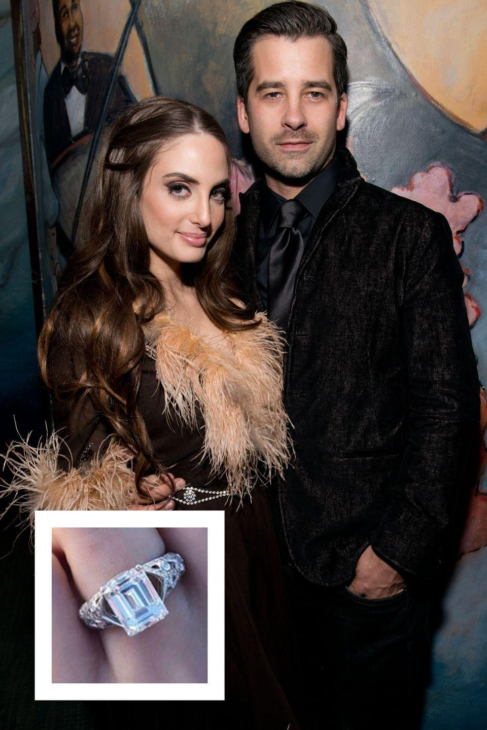 """<p>Joel, the daughter of Billy Joel and Christie Brinkley, and longtime boyfriend Ryan Gleason rang in 2018 with the happy news of their engagement. <a href=""""https://www.townandcountrymag.com/society/a14532125/alexa-ray-joel-engaged/"""" rel=""""nofollow noopener"""" target=""""_blank"""" data-ylk=""""slk:Gleason proposed with a huge emerald-cut diamond ring"""" class=""""link rapid-noclick-resp"""">Gleason proposed with a huge emerald-cut diamond ring</a> set on a band with diamond detailing, which was designed by Carelle. </p>"""
