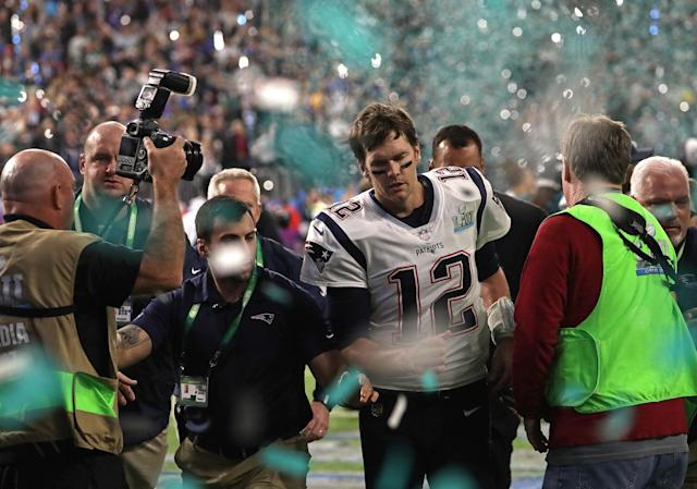 <p>New England Patriots quarterback Tom Brady (12) leaves the field after the loss. The New England Patriots play the Philadelphia Eagles in Super Bowl LII at US Bank Stadium in Minneapolis on Feb. 4, 2018. (Photo by Barry Chin/The Boston Globe via Getty Images) </p>