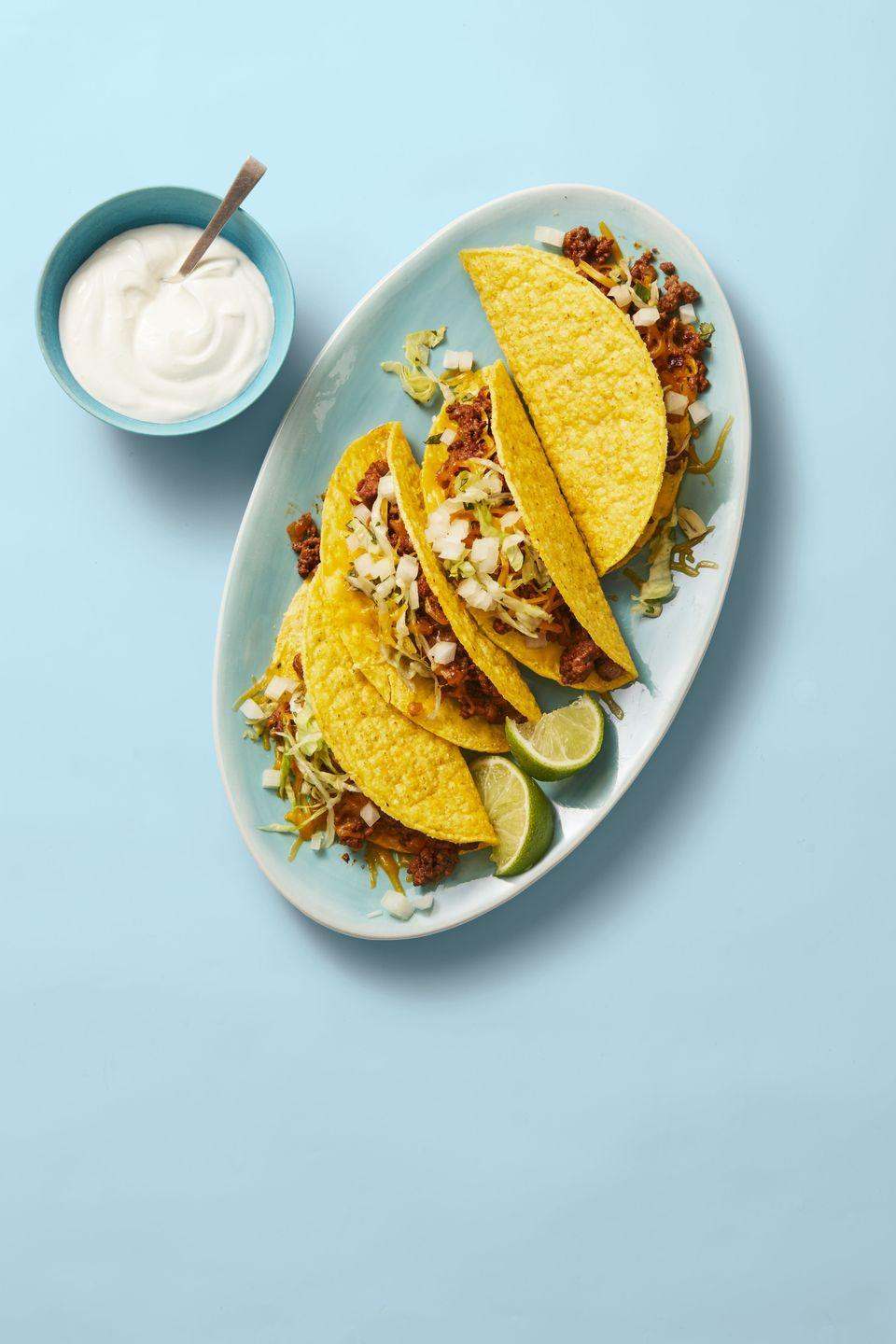 """<p>Lighten up taco night with our slightly spicy take on this crunchy family fave.</p><p><em><a href=""""https://www.goodhousekeeping.com/food-recipes/a29849486/turkey-tacos-recipe/"""" rel=""""nofollow noopener"""" target=""""_blank"""" data-ylk=""""slk:Get the recipe for Turkey Tacos »"""" class=""""link rapid-noclick-resp"""">Get the recipe for Turkey Tacos »</a></em></p>"""