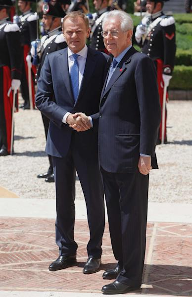Italian Premier Mario Monti, right, and Polish Prime Minister Donald Tusk shake hands during their meeting at Villa Madama, Rome, Tuesday, May 29, 2012. (AP Photo/Roberto Monaldo, Lapresse)
