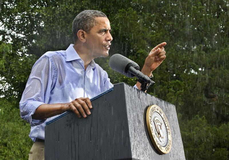 President Barack Obama campaigns for re-election in the heavy rain at Walkerton Tavern & Gardens in Glen Allen, Va., near Richmond, Saturday, July 14, 2012. The tavern is in the Congressional district represented by Republican House Majority Leader Eric Cantor, R-Va., and is a key county in a crucial swing state of the presidential election. (AP Photo/J. Scott Applewhite)