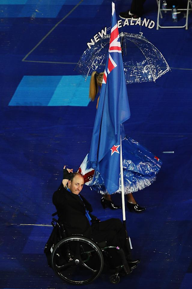 LONDON, ENGLAND - AUGUST 29: Michael Johnson of New Zealand carries the flag during the Opening Ceremony of the London 2012 Paralympics at the Olympic Stadium on August 29, 2012 in London, England. (Photo by Hannah Johnston/Getty Images)