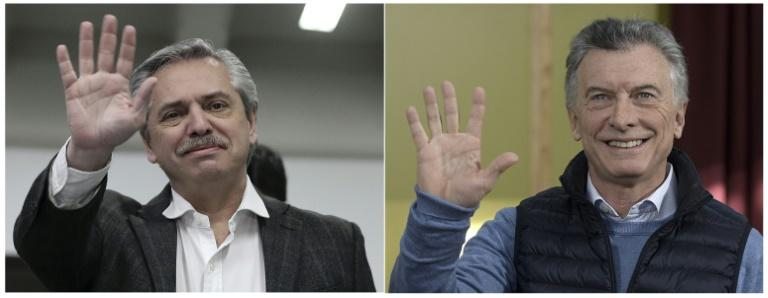 Alberto Fernandez, candidate of the Frente de Todos (Front for All) party, (L) was the top vote-getter in Argentina's presidential primaries, dealing a major blow to President Mauricio Macri, who is running for re-election (AFP Photo/Juan MABROMATA, Alejandro PAGNI)