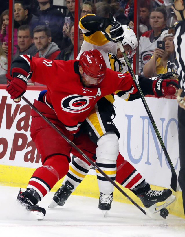 Carolina Hurricanes' Jordan Staal (11) tussles with Pittsburgh Penguins' Sidney Crosby (87) during the first period of an NHL hockey game, Saturday, Dec. 22, 2018, in Raleigh, N.C. (AP Photo/Karl B DeBlaker)