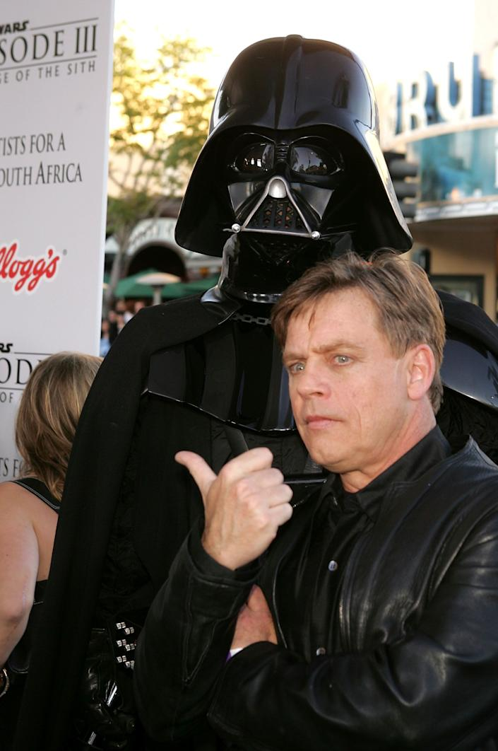 """Actor Mark Hamill and Darth Vader arrive at the """"Star Wars Episode III - Revenge Of The Sith"""" Los Angeles Premiere at the Mann Village Theatre on May 12, 2005 in Westwood, California. The premiere benefits the charity Artists for a New South Africa and its comprehensive, ground-breaking program for South African children orphaned by HIV/AIDS."""
